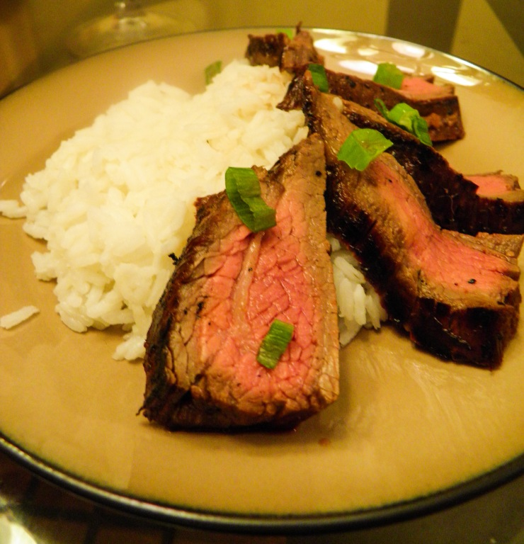 asian marinated flank steak plated