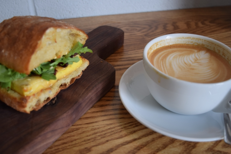 side latte and egg sandwich
